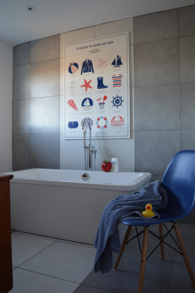 Bathroom freestanding bath Petit Bateau poster Eames chair grey white tile