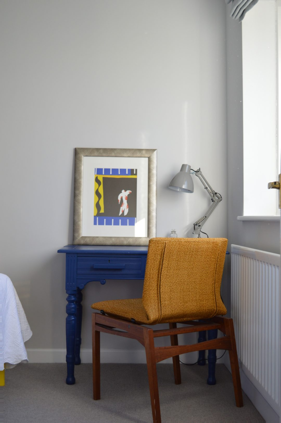 Spare bedroom Dulux Sapphire Salute desk mid century chair