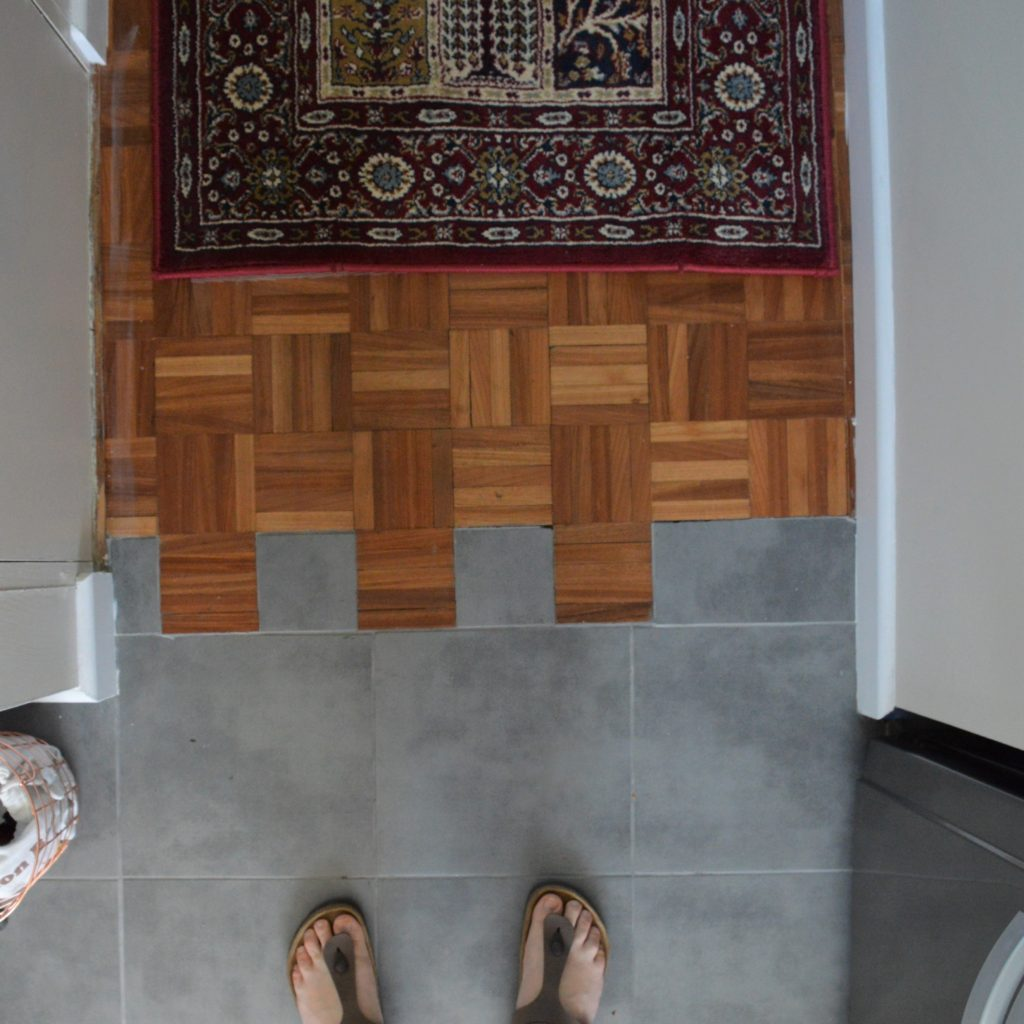 Floor transition wood parquet to tiles